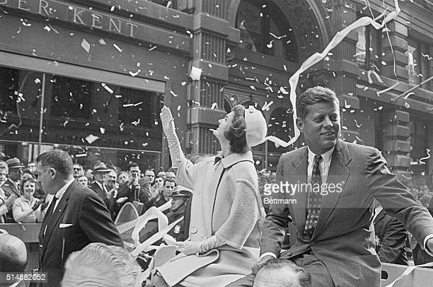 Presidential candidate John F Kennedy rides on a car with wife Jackie in a ticker tape parade The parade followed the 'Canyon of Heroes' the Wall...