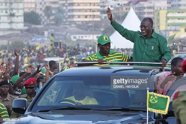 Presidential candidate John Magufuli waves to supporters after addressing a rally by ruling party Chama Cha Mapinduzi in Dar es Salaam Tanzania on...