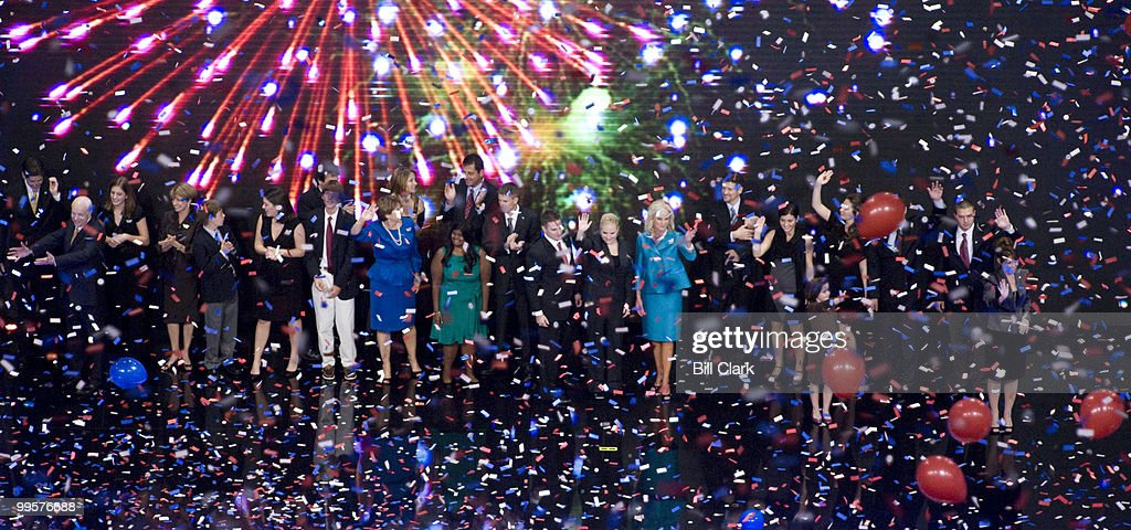 GOP presidential candidate John McCain, far left, waves to the crowd with the McCain and Palin families after his speech to the Republican National Convention at the Xcel Center in St. Paul, Minn., on Thursday, Sept. 4, 2008.