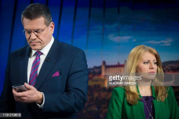 Presidential candidate Maros Sefcovic and candidate Zuzana Caputova get ready for a television debate at TV Markiza in Bratislava on March 17 one day...