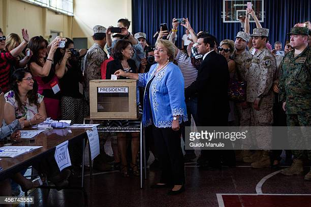 Presidential candidate Michelle Bachelet votes during the Presidential Ballotage in Chile between her and Evelyn Mattehi on December 15 2013 in...