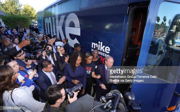 Presidential candidate Mike Bloomberg stands by his campaign bus after speaking at an event at the Dollarhide Community Center in Compton on Monday...