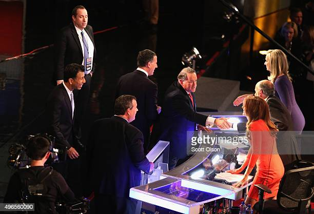 Presidential candidate Mike Huckabee shakes the hands of debate moderators Trish Regan Gerald Sieb and Sandra Smith after the Republican Presidential...