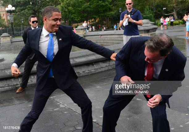 US Presidential candidate Mitt Romney impersonator Mike Cote fights with US President Barack Obama impersonator Reggie Brown during an Obama vs...