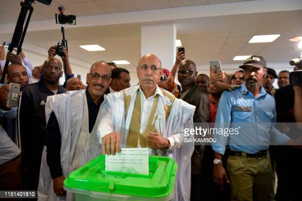 Presidential candidate Mohamed Ould Ghazouani casts his ballot at a polling station on June 22 2019 in Nouakchott during the presidential election in...