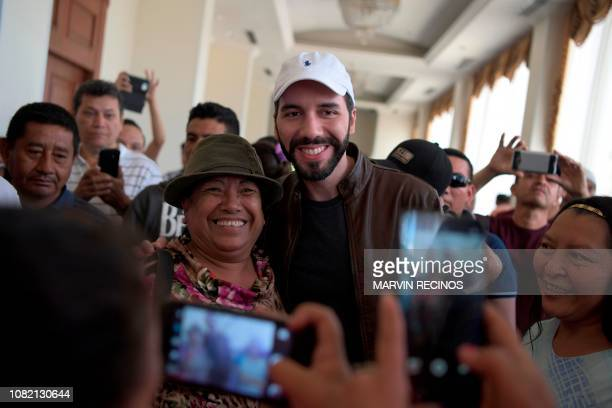 Presidential candidate Nayib Bukele of the Great National Alliance poses with a supporter as he participates in a meeting with members of the...
