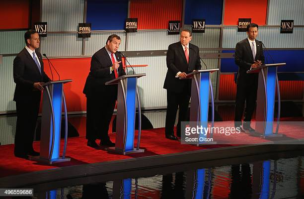 Presidential candidate New Jersey Gov Chris Christie speaks while Rick Santorum Mike Huckabee and Louisiana Gov Bobby Jindal look on during the...
