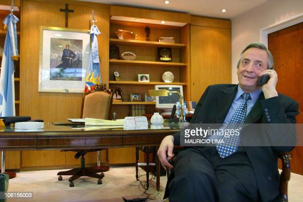 Presidential candidate Néstor Kirchner is seen on the phone in Rio Gallegos Argentina 28 April 2003 Kirchner will run against exPresident Carlos...