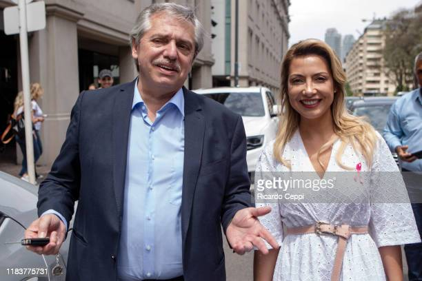 Presidential candidate of Frente de Todos Alberto Fernandez and his partner Fabiola Yañez are seen on the street after voting during the presidential...