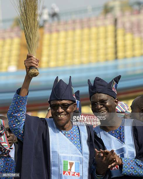 Presidential candidate of Nigeria's leading opposition All Progressive Congress Mohammadu Buhari and Lagos' governor Babatunde Fashola smile during a...