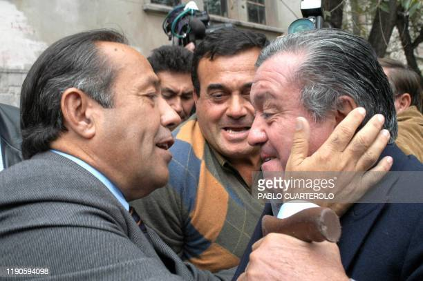 Presidential candidate of the MNP Adolfo Rodriguez Saá greets supporters after casting his vote during the presidential election 27 April 2003 in San...