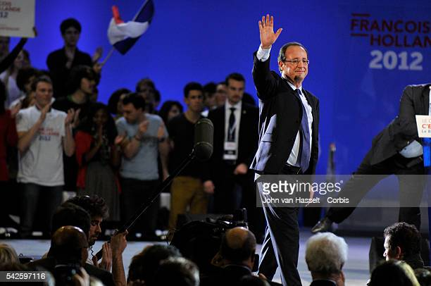 Presidential candidate of the Socialist Party for the 2012 French elections Francois Hollande speaks at his first big political meeting to his...
