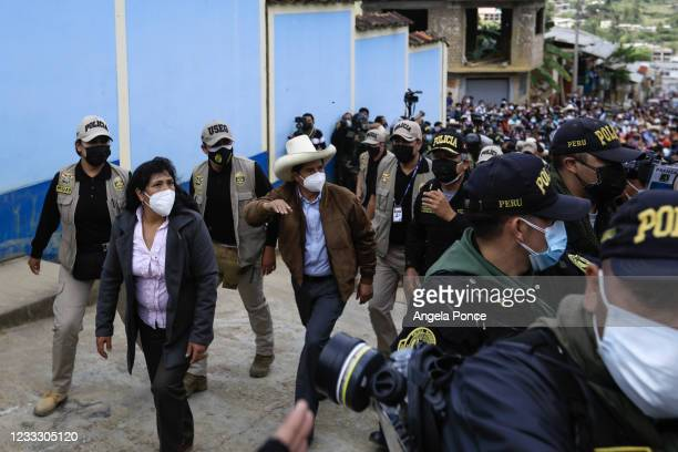 Presidential candidate Pedro Castillo of Peru arrives to cast his vote with his wife Lilia Paredes at a polling station during the presidential...