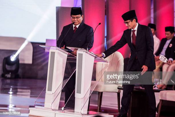 Presidential candidate Prabowo Subianto and his running mate Sandiaga Uno walk to the stage during a debate among candidates in Jakarta Indonesia 17...