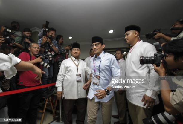 Presidential candidate Prabowo Subianto is seen with his partner Sandiaga Uno upon his arrival before the draw and determining the serial number of...