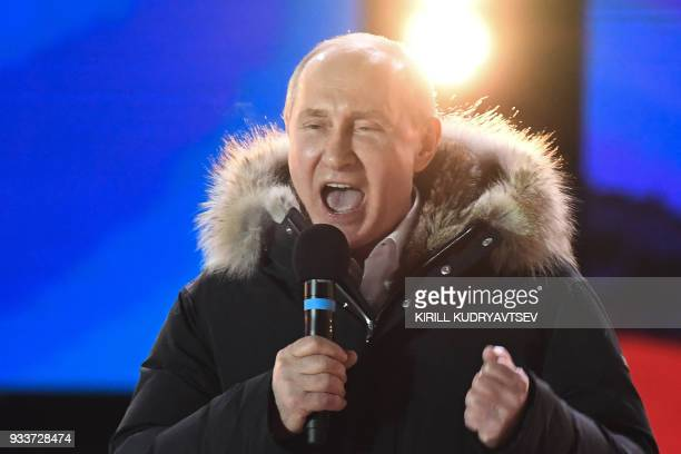 TOPSHOT Presidential candidate President Vladimir Putin addresses the crowd during a rally and a concert celebrating the fourth anniversary of...