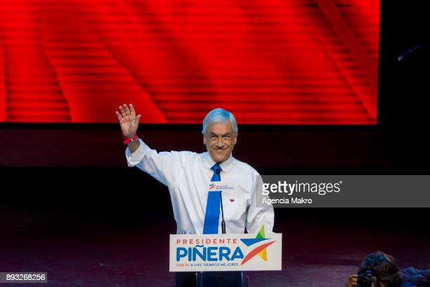Presidential candidate Sebastian Piñera greets his supporters during the closing rally of the campaign at the Caupolicán Theater on December 14 2017...