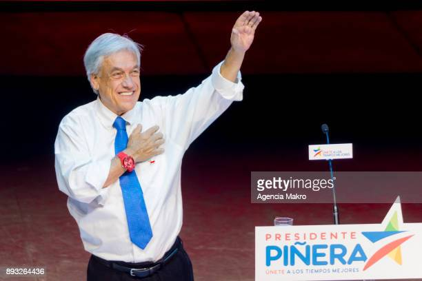 Presidential candidate Sebastian Piñera greets his supporters upon his arrival at the closing campaign rally at the Caupolicán Theate on December 14...
