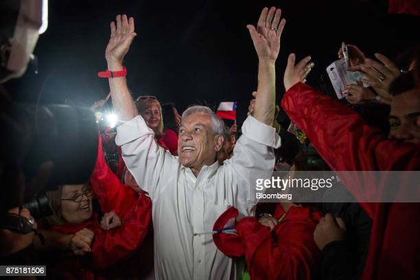 Presidential candidate Sebastian Pinera center stands with the supporters during a campaign rally in Santiago Chile on Thursday Nov 16 2017...