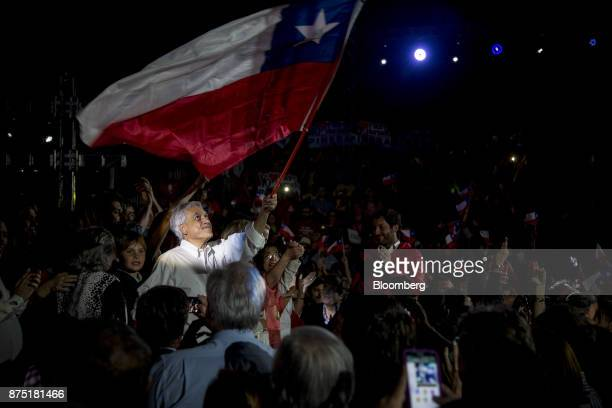 Presidential candidate Sebastian Pinera waves a Chilean national flag during a campaign rally in Santiago Chile on Thursday Nov 16 2017 Everything...