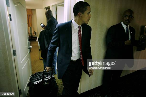 Presidential candidate Sen Barack Obama and his wife Michelle Obama advisor David Axelrod and communications director Robert Gibbs leave the hotel...
