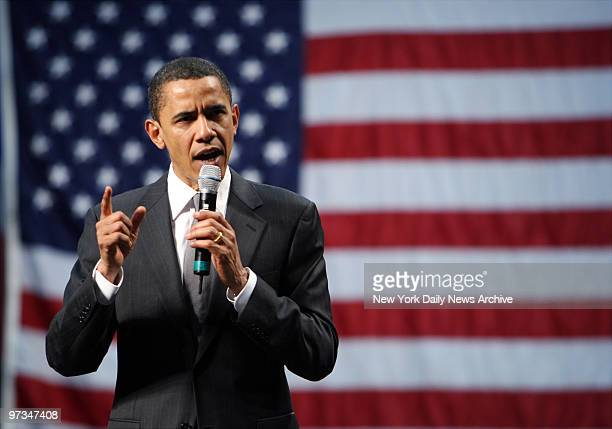 Presidential candidate Sen Barack Obama stands against the backdrop of an American flag as he speaks during a campaign rally at the University of...