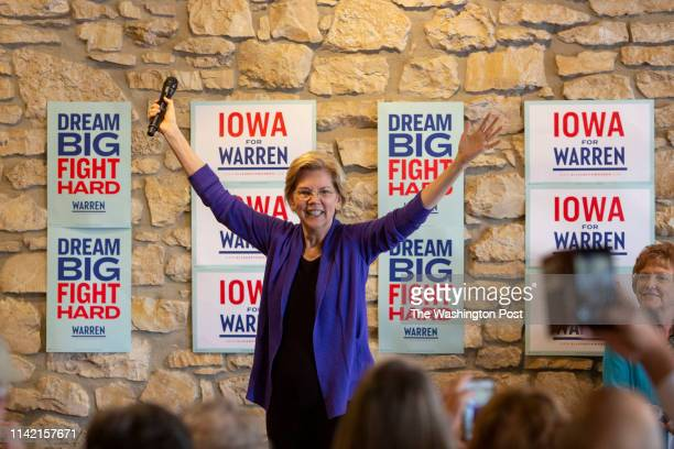 2020 presidential candidate Sen Elizabeth Warren acknowledges the crowd as she arrives to speak during a campaign event at Fat Hill Brewing in Mason...