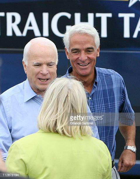 GOP presidential candidate Sen John McCain greets a supporter with Gov Charlie Crist right during a Joe The Plumber rally at All Star Building...