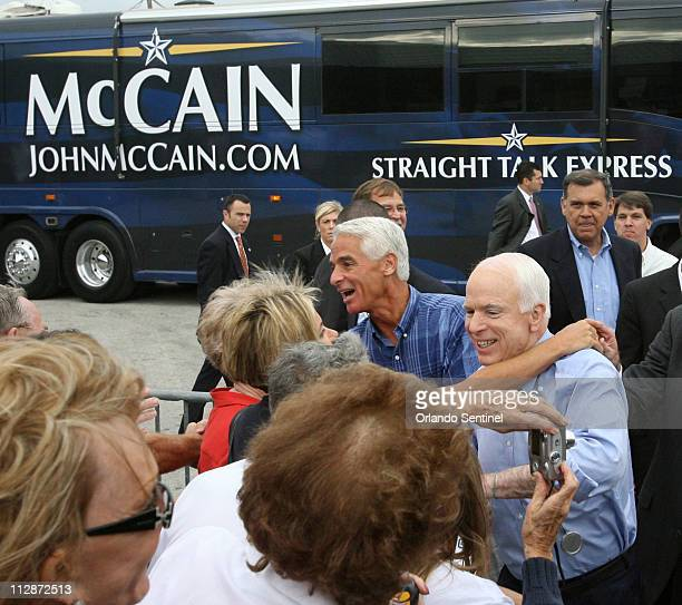 GOP presidential candidate Sen John McCain greets supporters with Gov Charlie Crist center during a Joe The Plumber rally at All Star Building...