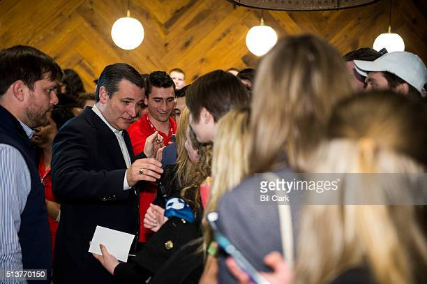 Presidential candidate Sen. Ted Cruz, R-Texas, shakes hands and takes photos with College Republicans at the The Walrus Oyster & Ale House at...
