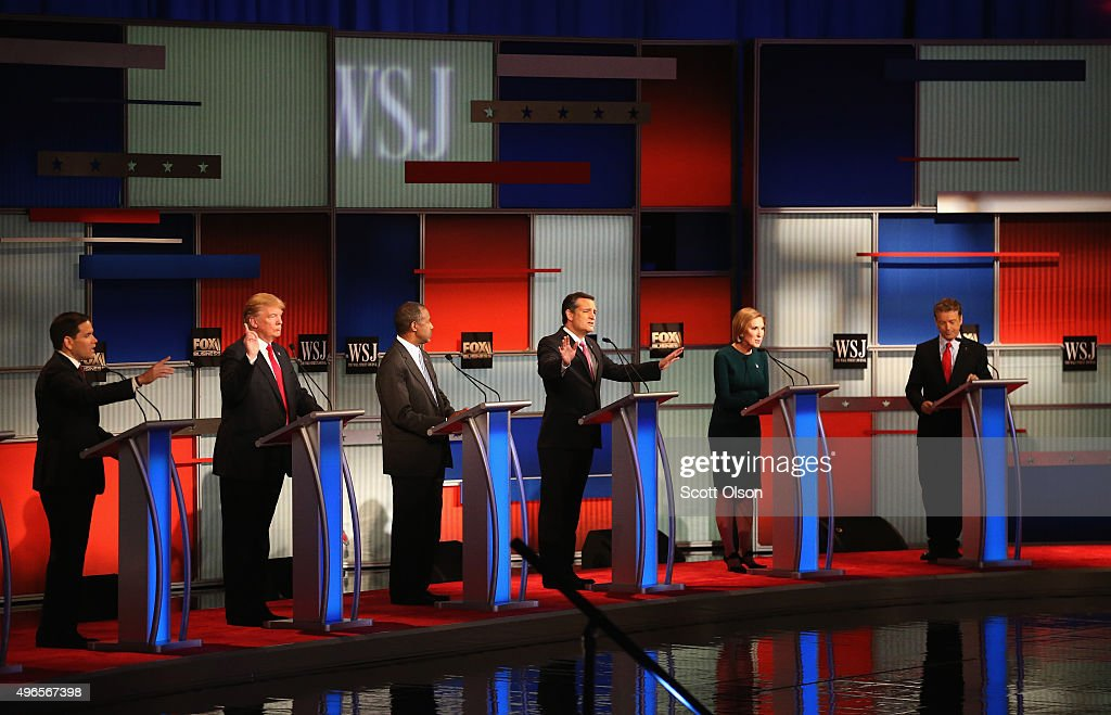 Presidential candidate Sen. Ted Cruz (R-TX) (3rd R) speaks while Sen. Marco Rubio (R-FL), Donald Trump, Ben Carson, Carly Fiorina, and Sen. Rand Paul (R-KY) take part in the Republican Presidential Debate sponsored by Fox Business and the Wall Street Journal at the Milwaukee Theatre November 10, 2015 in Milwaukee, Wisconsin. The fourth Republican debate is held in two parts, one main debate for the top eight candidates, and another for four other candidates lower in the current polls.