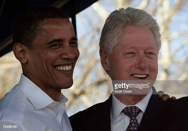 Presidential candidate Senator Barack Obama and former President Bill Clinton greet civil rights activist and supporters following a march across the...