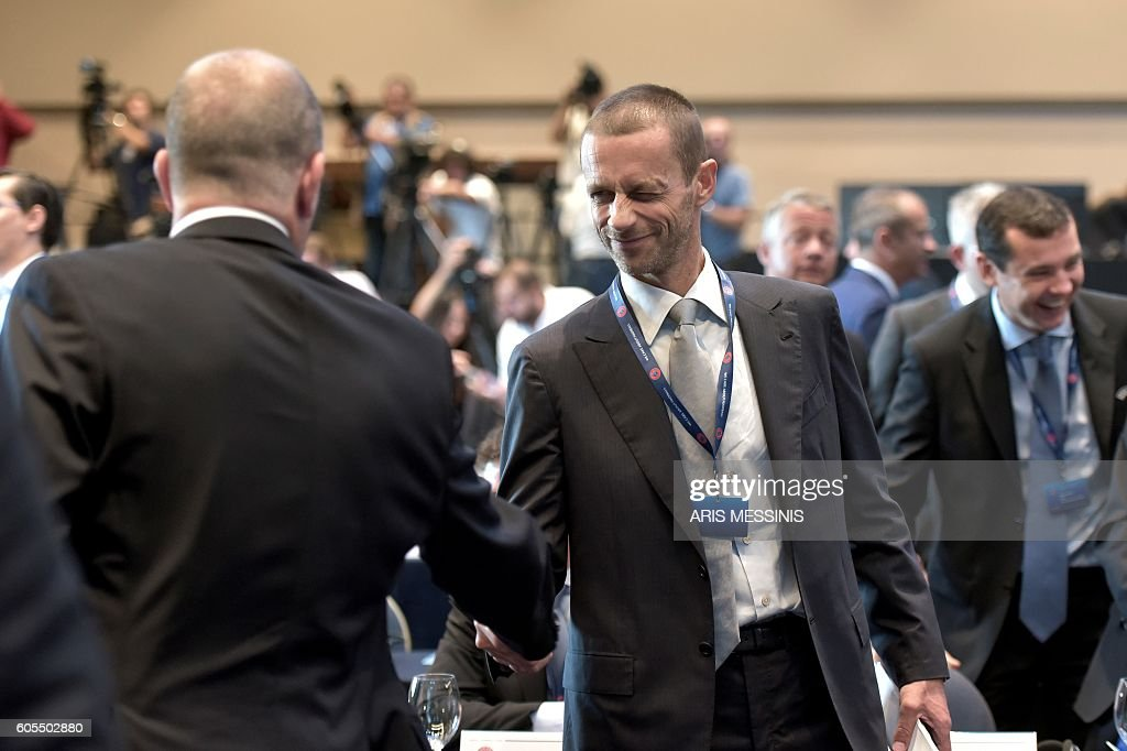 Presidential candidate, Slovenian Aleksander Ceferin (C) is pictured during the 12th Extraordinary UEFA congress in Lagonissi, some 40 kilometers south of Athens, on September 14, 2016. Disgraced football leader Michel Platini said on September 14 in a farewell speech to UEFA that he felt no guilt over a $2 million payment from FIFA that has seen him suspended for four years. / AFP / ARIS