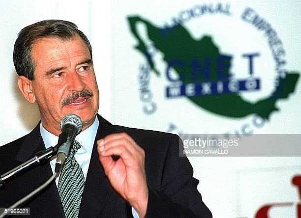 Presidential candidate Vicente Fox delivers a speech during the annual assembly of the Council of Turistico Enterprise in Mexico City 22 June 2000 El...