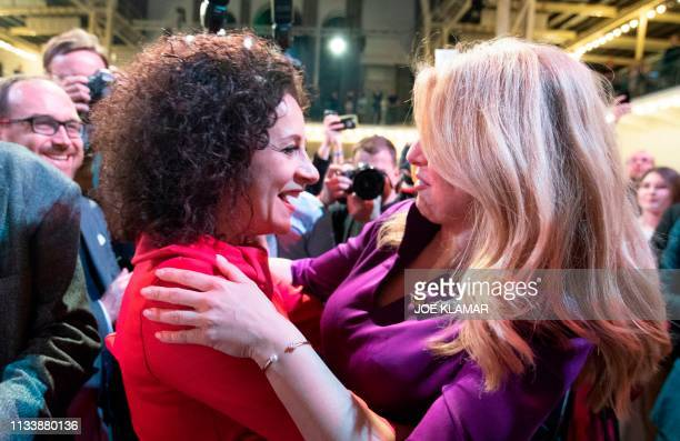 Presidential candidate Zuzana Caputova is congratulated as she takes a big lead after the first exit polls in her election's headquarters in...