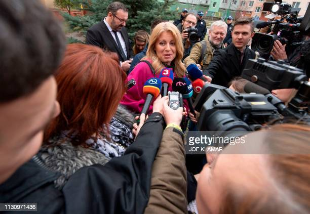Presidential candidate Zuzana Caputova speaks to journalists after she casted her vote at a polling station in Pezinok Slovakia during the first...