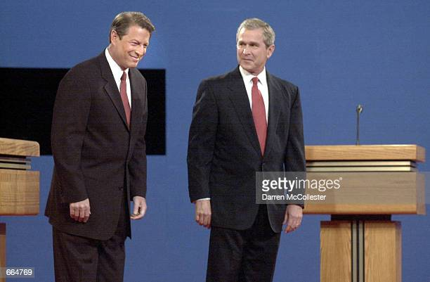Presidential candidates Democratic Vice President Al Gore left and Republican Texas Governor George W Bush arrive on stage for their first debate...