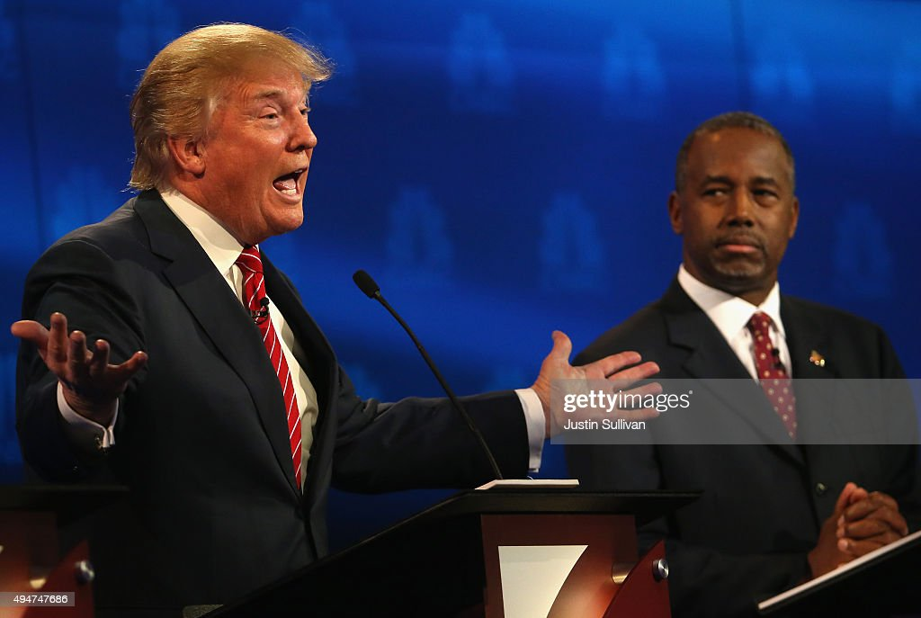 Presidential candidates Donald Trump (L) speaks while Ben Carson looks on during the CNBC Republican Presidential Debate at University of Colorados Coors Events Center October 28, 2015 in Boulder, Colorado. Fourteen Republican presidential candidates are participating in the third set of Republican presidential debates.