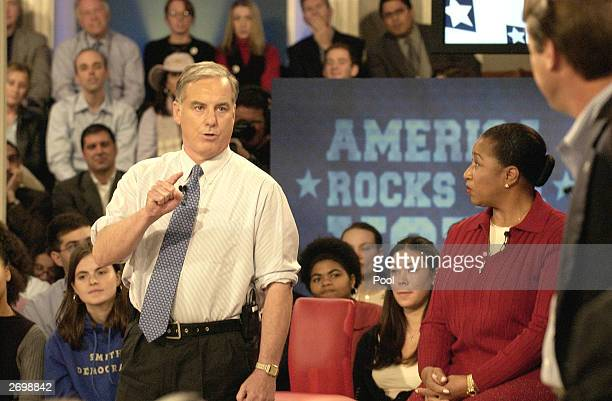 S Presidential candidates Howard Dean gestures as he responds to US Senator John Edwards as Carol Moseley Brown looks on during a forum sponsored by...