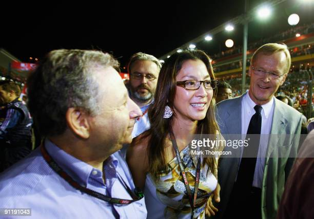 A Presidential candidates Jean Todt and Ari Vatanen meet on the grid before the Singapore Formula One Grand Prix at the Marina Bay Street Circuit on...