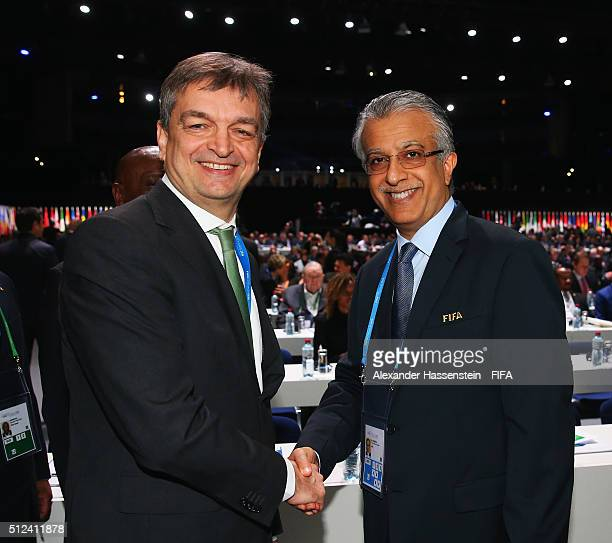 Presidential candidates Jerome Champagne and Sheikh Salman Bin Ebrahim Al Khalifa shake hands prior to the Extraordinary FIFA Congress at...