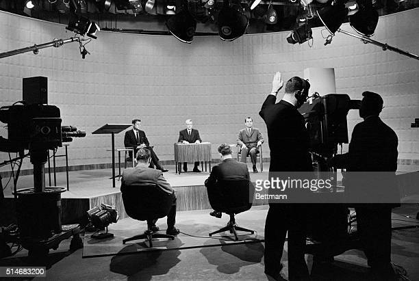 Presidential candidates John F. Kennedy and Richard Nixon debate in a television studio during the 1960 election.