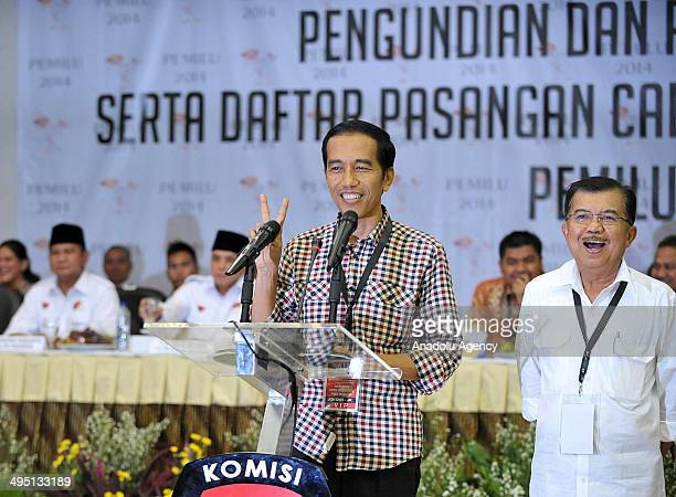 Presidential candidates Joko Widodo accompanied by his running mate Jusuf Kalla giving spech after they get the serial number for the Presidential...