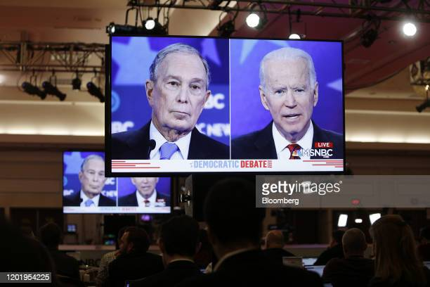2020 presidential candidates Michael Bloomberg founder of Bloomberg LP and Former Vice President Joe Biden are seen on television screens during the...