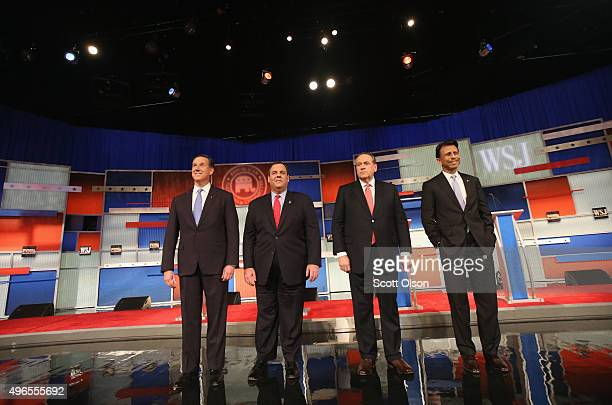 Presidential candidates Rick Santorum New Jersey Governor Chris Christie Mike Huckabee and Louisiana Governor Bobby Jindal take the stage during the...