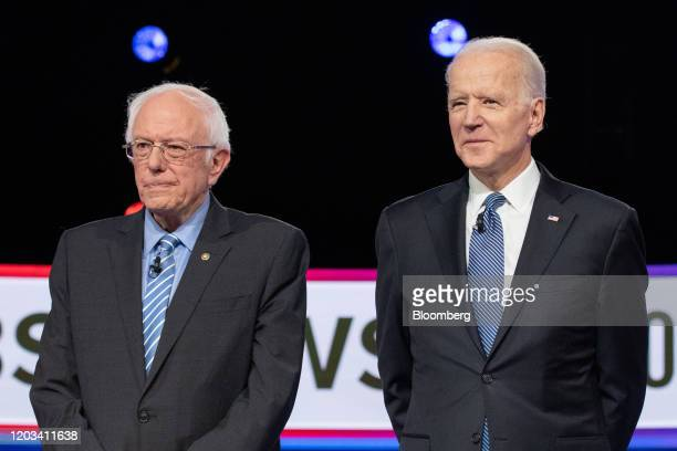 2020 presidential candidates Senator Bernie Sanders an Independent from Vermont left and former Vice President Joe Biden arrive on stage ahead of the...
