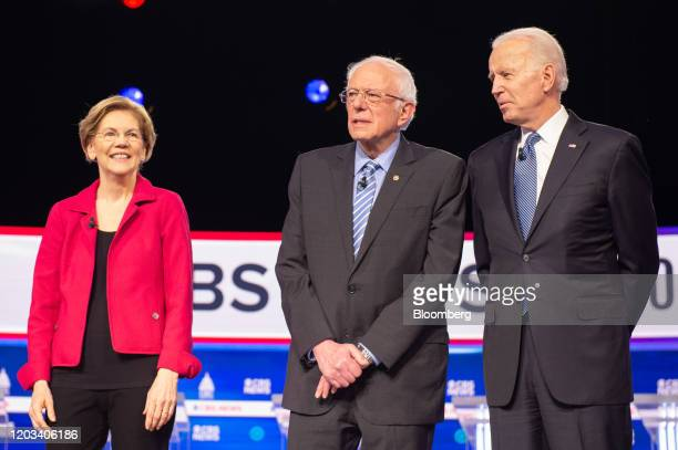 Presidential candidates Senator Elizabeth Warren, a Democrat from Massachusetts, left, Senator Bernie Sanders, an Independent from Vermont, and...