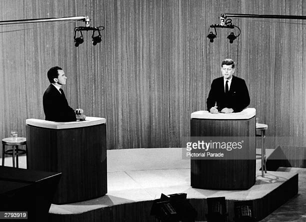 Republican vice president Richard Nixon and democratic senator John F Kennedy stand at podia and take part in a televised debate during their...