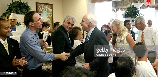 GOP presidential contender Sen John McCain greets Orange Republican chairman Lew Oliver and others with Florida Gov Charlie Crist during a stop at...