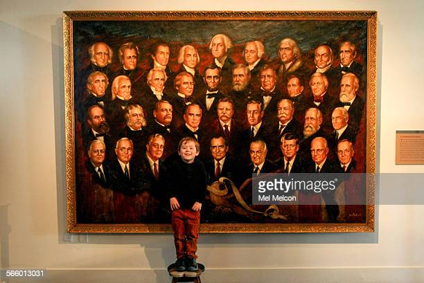 Presidential enthusiast Arden Hayes poses in front of a painting titled A Presidential Pantheon by artist Victor Lee that depicts President Richard...